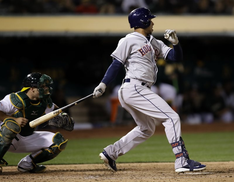 Houston Astros' Michael Brantley watches his RBI single against the Oakland Athletics during the sixth inning of a baseball game Wednesday, April 17, 2019, in Oakland, Calif. (AP Photo/Ben Margot)