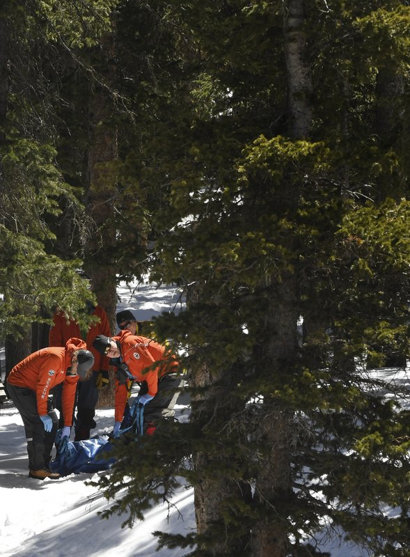 Members of an Alpine Rescue Team carry out the body of 18-year-old Sol Pais, near Echo Lake Campground in Arapaho National Forest, Wednesday, April 17, 2019 in Idaho Springs, Colo. (RJ Sangosti/The Denver Post via AP)