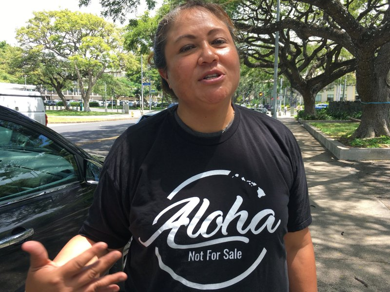 This Friday, April 12, 2019 photo shows Healani Sonoda-Pale, chairwoman of the Ka Lahui Hawaii political action committee, wearing a T-shirt saying