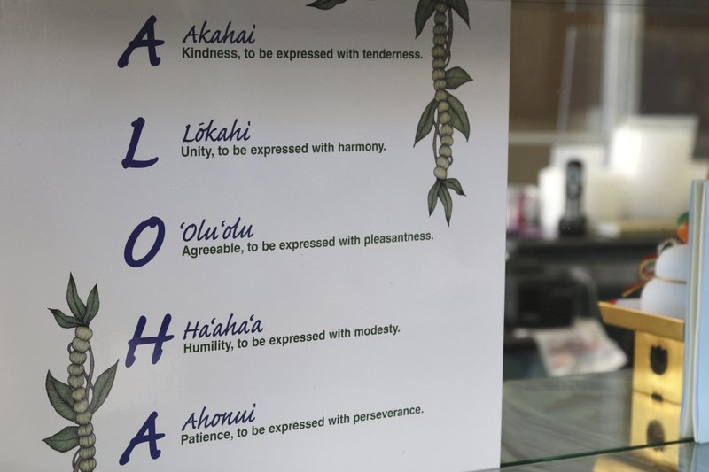 This Tuesday, April 16, 2019 photo shows a sign inside Aloha Poke Shop, a store in Honolulu that received a letter from Chicago-based Aloha Poke Co. (AP Photo/Audrey McAvoy)
