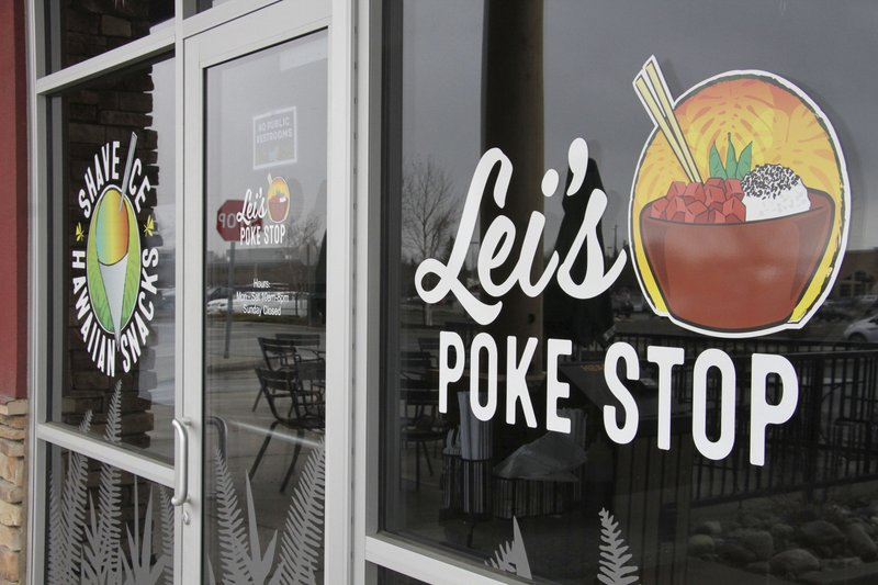 The exterior of Lei's Poke Stop is seen Wednesday, April 17, 2019, in Anchorage, Alaska. Hawaii lawmakers are considering adopting a resolution calling for the creation of legal protections for Native Hawaiian cultural intellectual property. (AP Photo/Mark Thiessen)