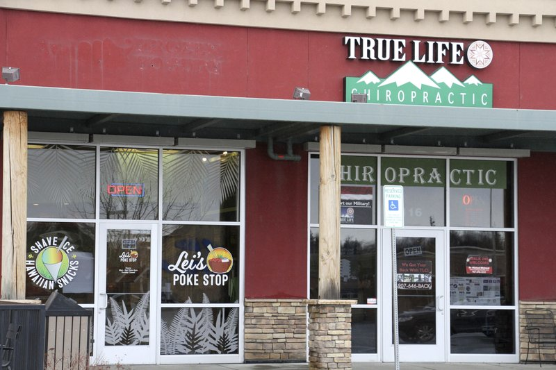 The exterior of Lei's Poke Stop, at left, is seen Wednesday, April 17, 2019, in Anchorage, Alaska. Hawaii lawmakers are considering adopting a resolution calling for the creation of legal protections for Native Hawaiian cultural intellectual property. (AP Photo/Mark Thiessen)