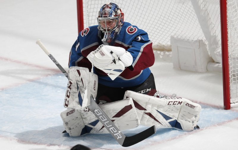 Colorado Avalanche goaltender Philipp Grubauer makes a glove save of a shot by the Calgary Flames during the first period of Game 4 of an NHL hockey playoff series Wednesday, April 17, 2019, in Denver. (AP Photo/David Zalubowski)