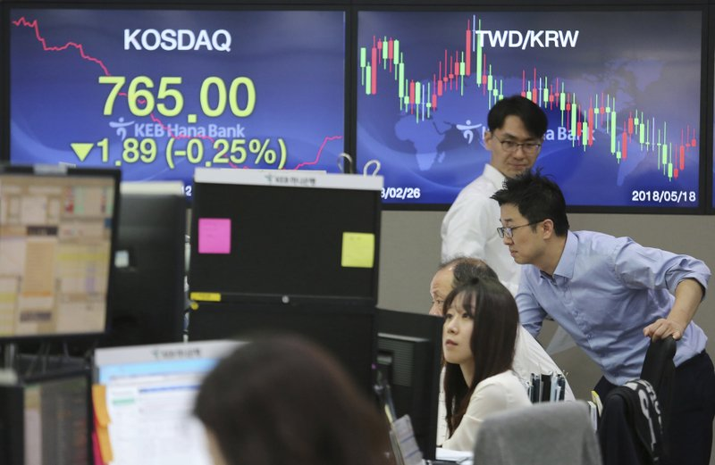 Currency traders watch monitors at the foreign exchange dealing room of the KEB Hana Bank headquarters in Seoul, South Korea, Thursday, April 18, 2019. (AP Photo/Ahn Young-joon)