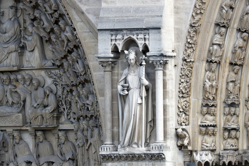 A statue is pictured just outside Notre Dame cathedral Wednesday, April 17, 2019 in Paris. Notre Dame Cathedral would have been completely burned to the ground in a