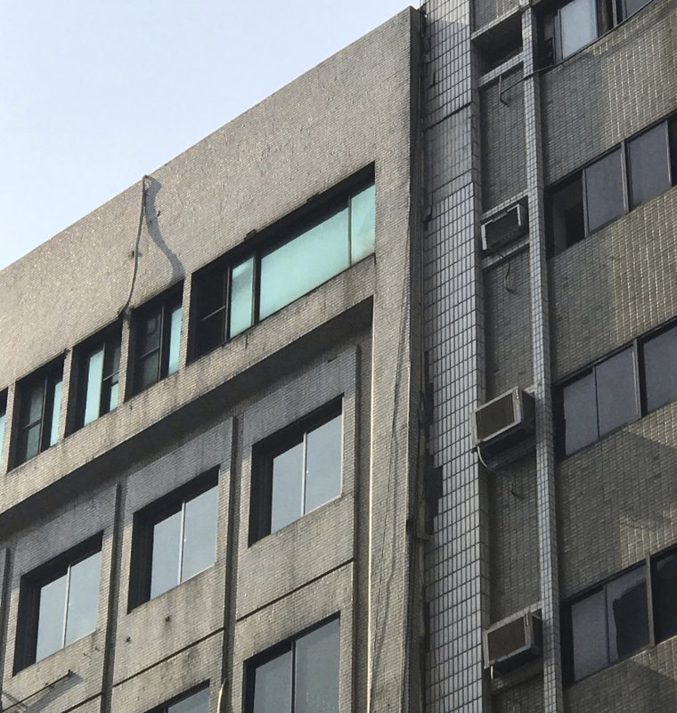 This image shows a damage at a building in Taipei, Taiwan following an earthquake Thursday, April 18, 2019. (AP Photo/Johnson Lai)