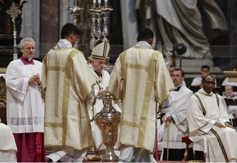 Pope Francis stands next to an amphora containing holy oil during a Chrism Mass inside St. Peter's Basilica, at the Vatican, Thursday, April 18, 2019. (AP Photo/Alessandra Tarantino)