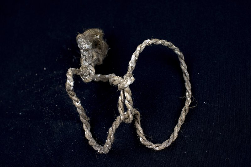In this Thursday, March 26, 2019 photo, a rope found tied at the wrists of a human skeleton and photographed after being exhumed from a mass grave at the cemetery of Paterna, near Valencia, Spain, as archaeologists conduct forensic analysis of the remains. (AP Photo/Emilio Morenatti)