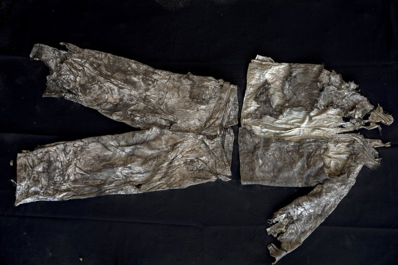 In this Thursday, March 26, 2019 photo, the clothes of a victim with monogram 'MG