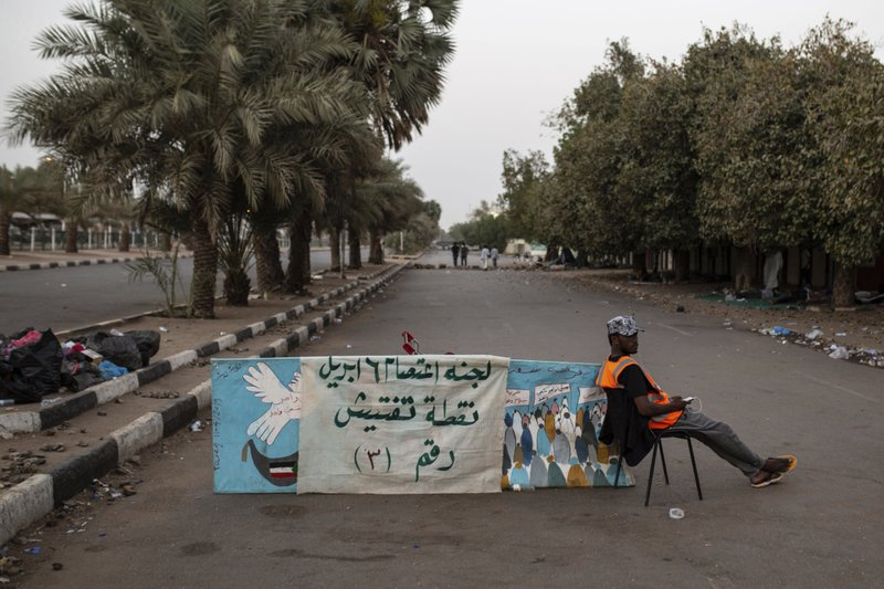 A protesters mans a checkpoint at entrance number three to the  sit-in inside the Armed Forces Square, in Khartoum, Sudan, Wednesday, April 17, 2019. (AP Photos/Salih Basheer)