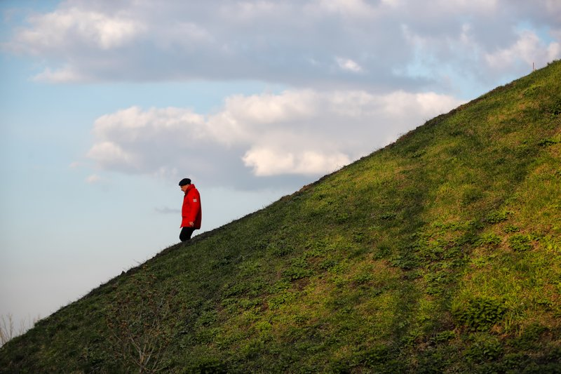 A man walks down a slope in a park in Kiev, Ukraine, Wednesday, April 17, 2019. The second round of presidential vote in Ukraine will take place on April 21. (AP Photo/Vadim Ghirda)
