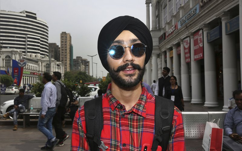 In this Tuesday, April 16, 2019, photo, Rajanvir Singh Luthra, 23, a You Tube vlogger, stands for a photograph in New Delhi, India. (AP Photo/Manish Swarup)