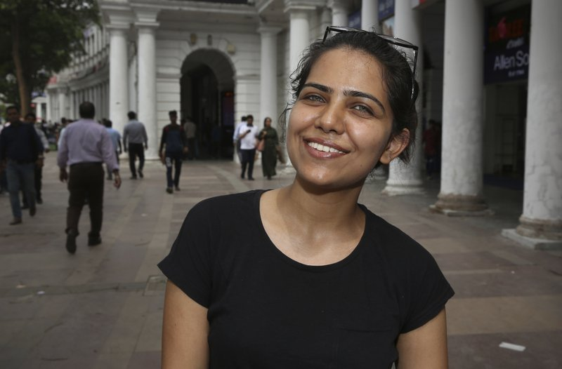 In this Tuesday, April 16, 2019, photo, Monika Dalal, 20, a psychology student talks to associated Press in New Delhi, India. (AP Photo/Manish Swarup)