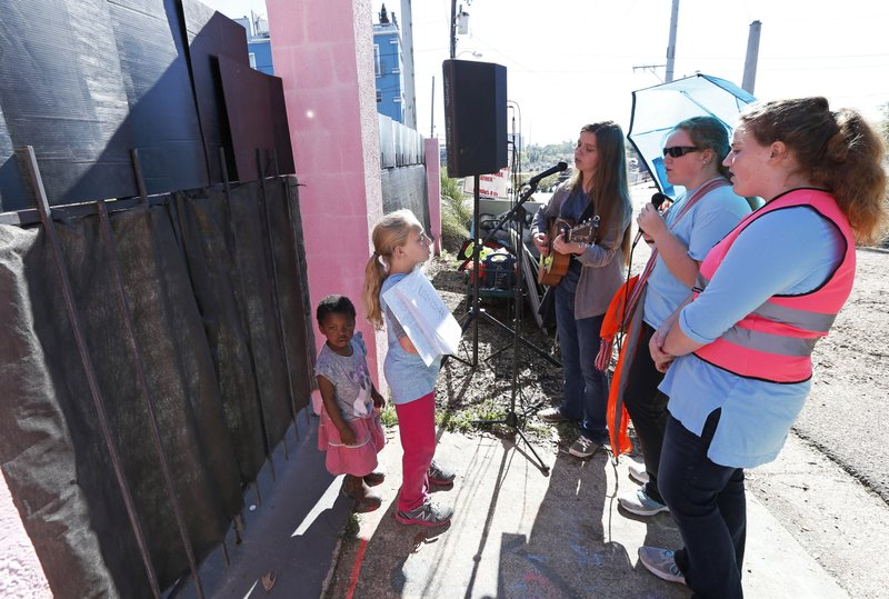 Children of abortion opponents, sing outside Jackson Women's Health Organization clinic in Jackson, Miss. (AP Photo/Rogelio V. Solis)