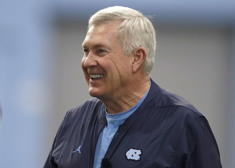 FILE - In this March 3, 2019 file photo, North Carolina coach Mack Brown smiles during the NCAA college football team's first practice of the season in Chapel Hill, N. (Ethan Hyman/The News & Observer via AP, File)