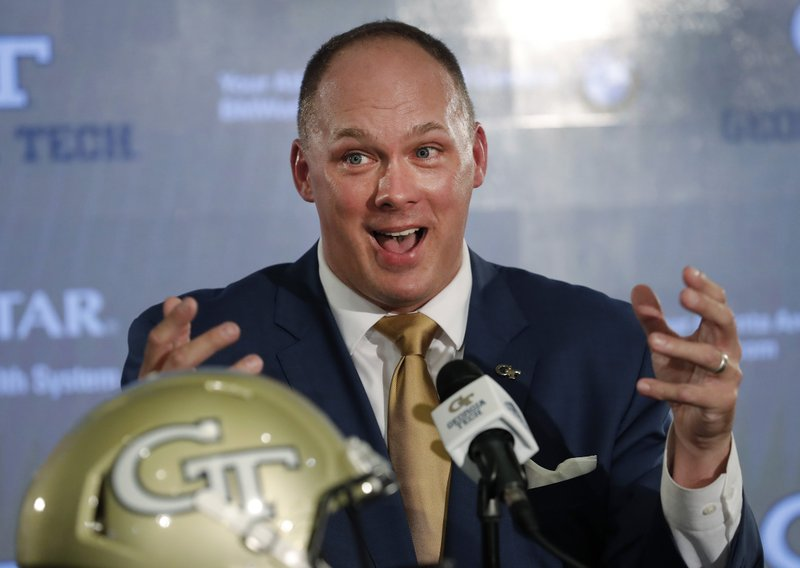 FILE - In this Dec. 7, 2018, file photo, newly hired Georgia Tech football coach Geoff Collins speaks during a news conference in Atlanta. (AP Photo/John Bazemore, File)