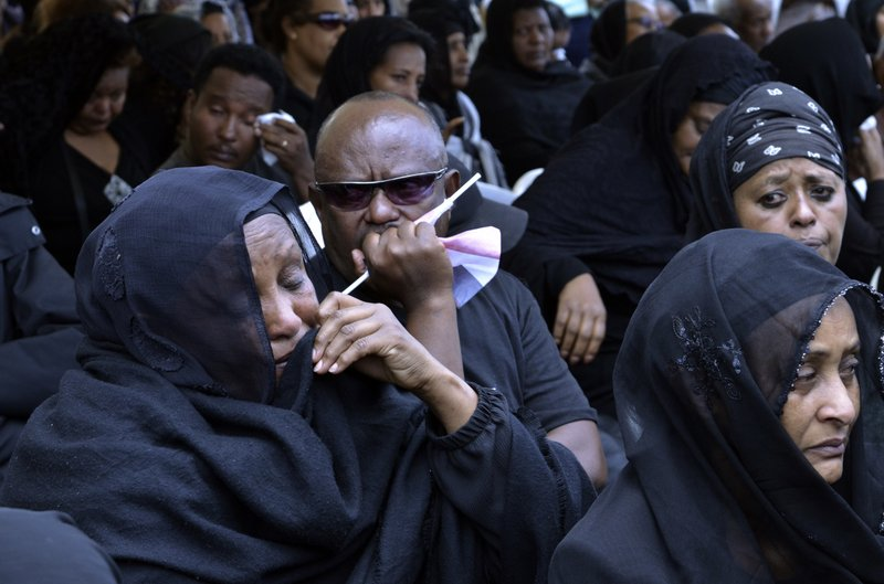 Family members of the Ethiopian airlines crash victims hold the 40th day remembrance, as per Ethiopian tradition, in Bishoftu, Ethiopia, Thursday, April 18, 2019. (AP Photo/Samuel Habtab)