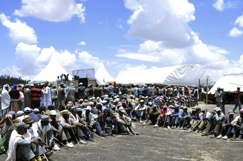 Ethiopians and family members of the Ethiopian airlines crash victims hold the 40th day remembrance, as per Ethiopian tradition, in Bishoftu, Ethiopia, Thursday, April 18, 2019. (AP Photo/Samuel Habtab)