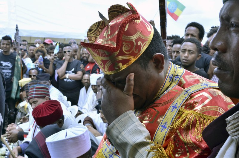 Ethiopian and family members of the Ethiopian airlines crash victims hold the 40th day remembrance, as per Ethiopian tradition, in Bishoftu, Ethiopia, Thursday, April 18, 2019. (AP Photo/Samuel Habtab)