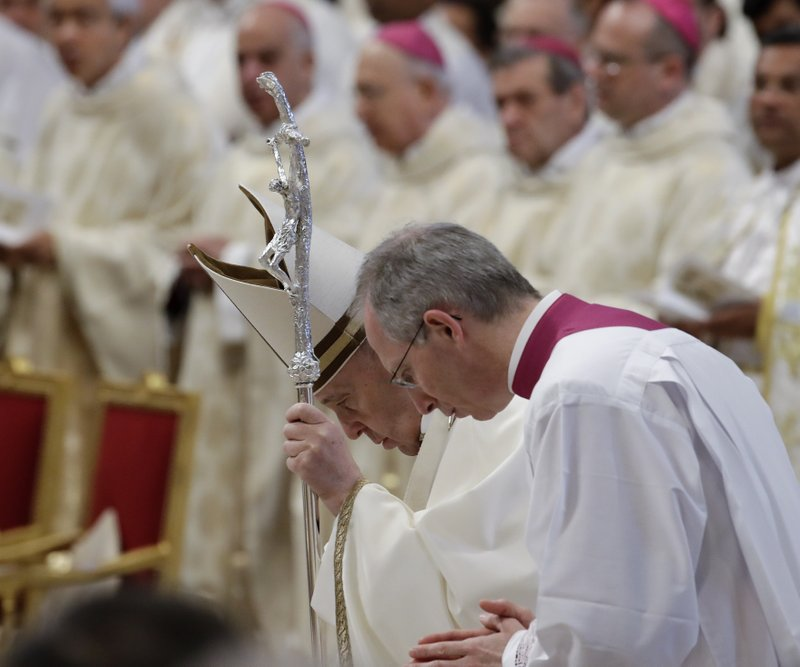 Pope Francis is flanked by Monsignor Guido Marini during a Chrism Mass inside St. Peter's Basilica, at the Vatican, Thursday, April 18, 2019. (AP Photo/Alessandra Tarantino)