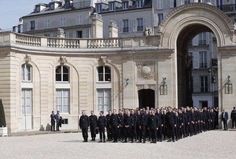 Emergency service personnel arrive at the Elysee Palace in Paris prior to a meeting with French President Emmanuel Macron, Thursday, April 18, 2019. (AP Photo/Thibault Camus)