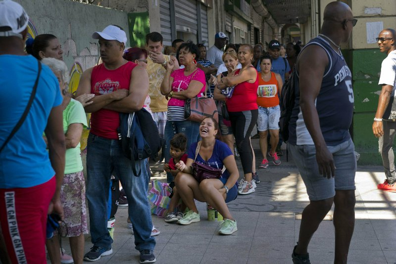 People wait in line to buy chicken at a government-run grocery store in Havana, Cuba, Wednesday, April 17, 2019. (AP Photo/Ramon Espinosa)