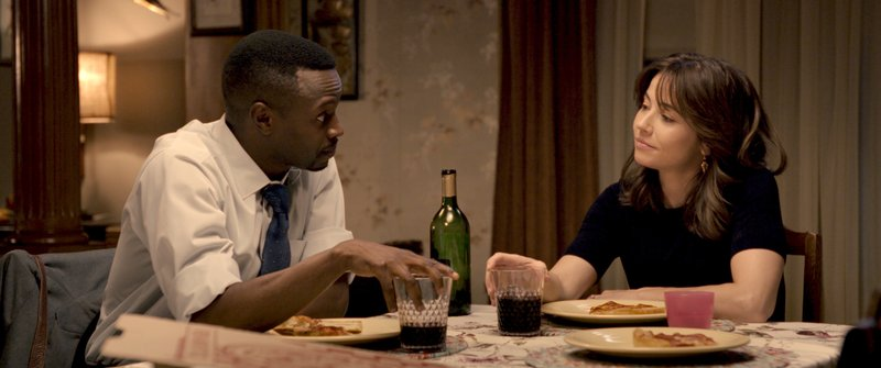 This image released by Warner Bros. Pictures shows Sean Patrick Thomas, left, and Linda Cardellini in a scene from