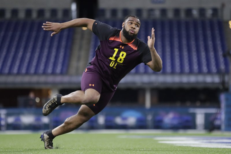 FILE - In this March 3, 2019, file photo, Clemson defensive lineman Christian Wilkins runs a drill at the NFL football scouting combine in Indianapolis. (AP Photo/Michael Conroy, File)