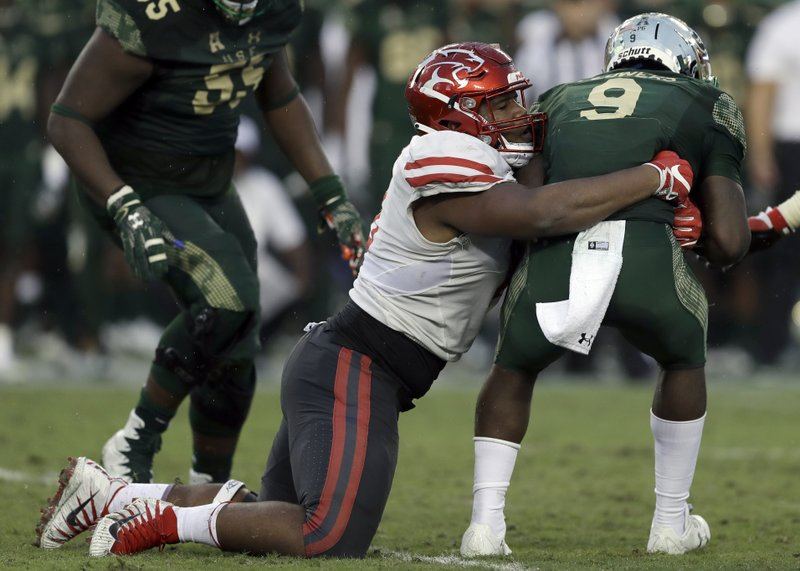 FILE - In this Oct. 28, 2017, file photo, Houston defensive tackle Ed Oliver (10) sacks South Florida quarterback Quinton Flowers (9) during the second half of an NCAA college football game, in Tampa, Fla. (AP Photo/Chris O'Meara, File)