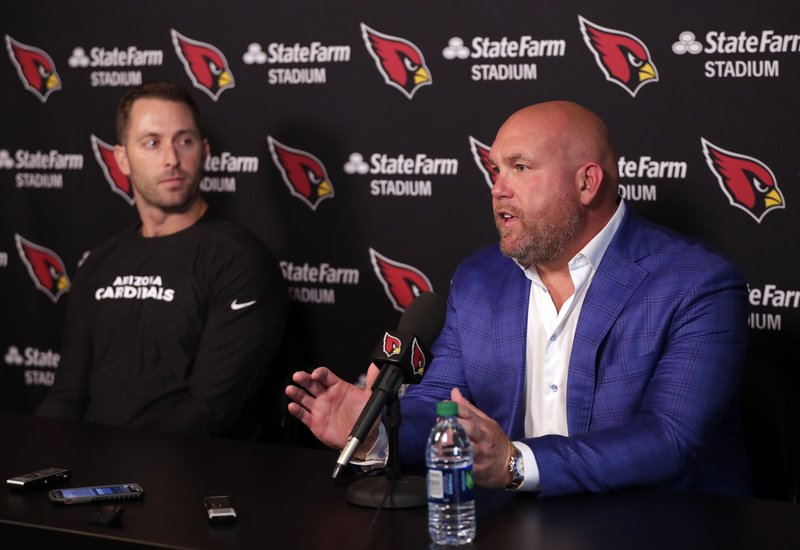 Arizona Cardinals head coach Kliff Kingsbury, left, and general manager Steve Keim  discusses the upcoming NFL football draft during a news conference, Tuesday, April 16, 2019, in Tempe, Ariz. (AP Photo/Matt York)