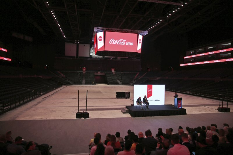 In this Tuesday, April 16, 2019 photo, Journalists take part at press conference with spokespersons from Meraas, Coca-Cola and AEG Ogden, at the Coca Cola Arena in Dubai, United Arab Emirates. (AP Photo/Kamran Jebreili)
