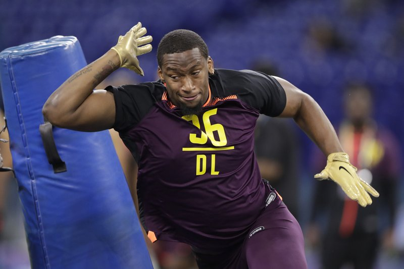 FILE - In this March 3, 2019, file photo, Clemson defensive lineman Clelin Ferrell runs a drill at the NFL football scouting combine, in Indianapolis. (AP Photo/Michael Conroy, File)