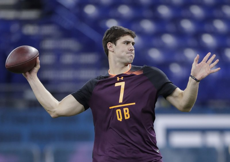 FILE - In this March 2, 2019, file photo, Duke quarterback Daniel Jones runs a drill at the NFL football scouting combine in Indianapolis. (AP Photo/Michael Conroy, File)
