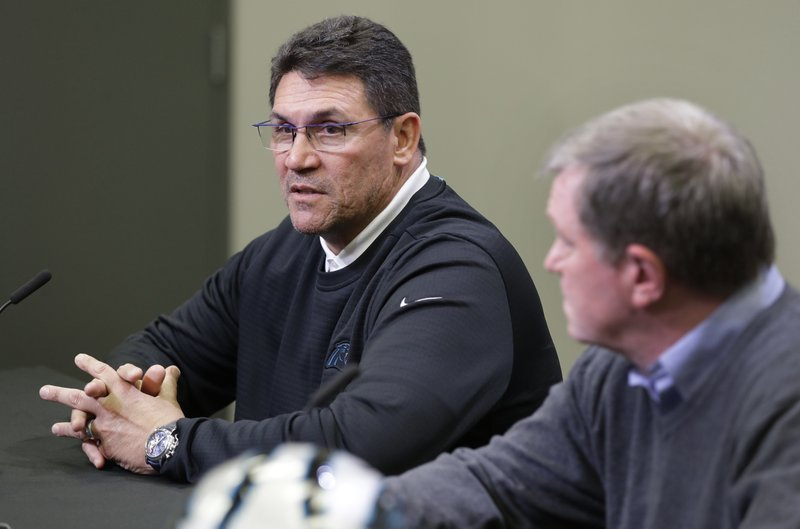Carolina Panthers head coach Ron Rivera, left, speaks to the media as general manager Marty Hurney listens in Charlotte, N. (AP Photo/Chuck Burton)