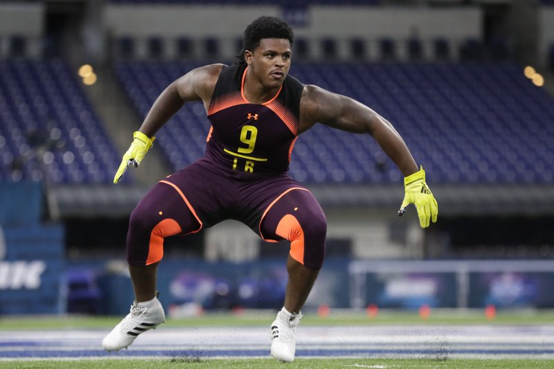 FILE - In this March 3, 2019, file photo, Michigan linebacker Devin Bush runs a drill at the NFL football scouting combine, in Indianapolis. (AP Photo/Michael Conroy, File)