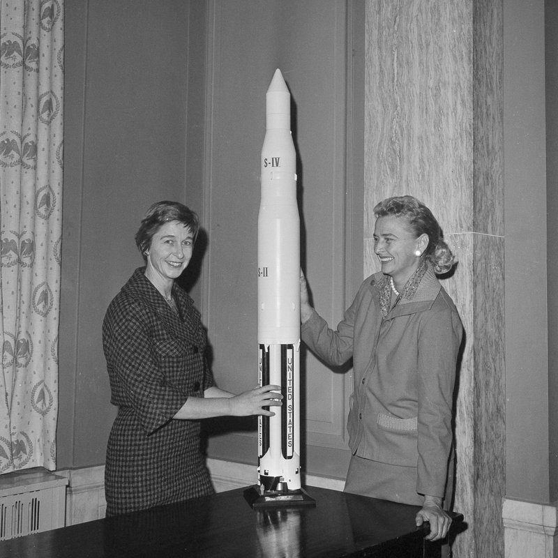 FILE - In this March 13, 1962 file photo, Jane Hart, left, wife of Sen. Philip Hart, D-Mich., and Jerrie Cobb of Oklahoma City pose with a model of a Saturn rocket at Capitol Hill in Washington. (AP Photo/Henry Griffin)
