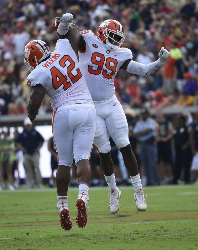 FILE - in this Sept. 22, 2018, file photo, Clemson defensive end Clelin Ferrell (99) and defensive lineman Christian Wilkins (42) celebrate a tackle against Georgia Tech during the first half of an NCAA college football game in Atlanta. (AP Photo/Jon Barash, File)