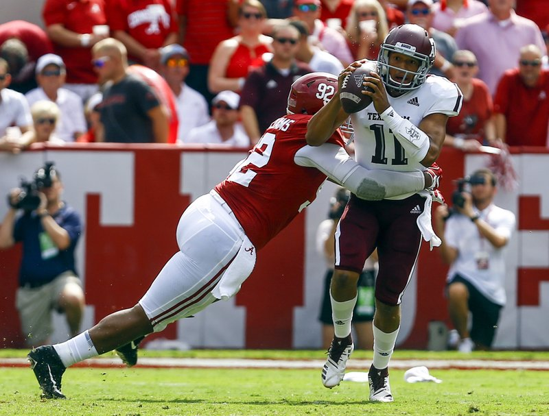 FILE - In this Sept. 22, 2018, file photo, Texas A&M quarterback Kellen Mond (11) is hit by Alabama defensive lineman Quinnen Williams (92) as he throws the ball during the first half of an NCAA college football game, in Tuscaloosa, Ala. (AP Photo/Butch Dill, File)