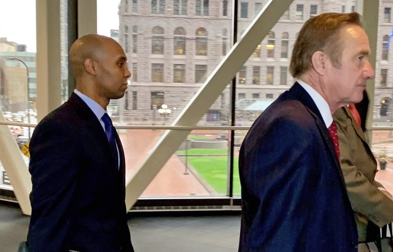 Former Minneapolis police officer Mohamed Noor, left, arrived with his defense attorneys Peter Wold, center, and Thomas Plunkett, right, partially hidden, on April 17, 2019, before another day of testimony in Noor's murder and manslaughter trial in Minneapolis. (AP Photo/Jeff Baenen)