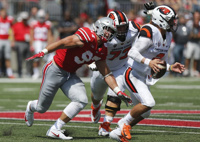 FILE - In this Sept. 1, 2018, file photo, Ohio State defensive lineman Nick Bosa plays against Oregon State during an NCAA college football game, in Columbus, Ohio. (AP Photo/Jay LaPrete, File)