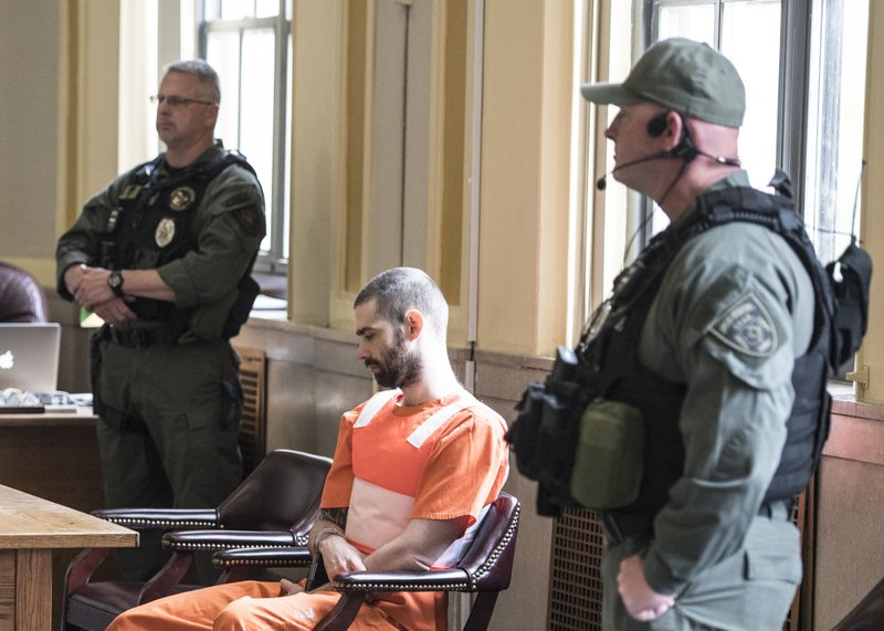 In this Wednesday, April 17, 2019 photo, Case Pigge, heavily guarded, waits in a Scioto County Courtroom in Chillicothe, Ohio. (Robert McGraw/The Chillicothe Gazette via AP)