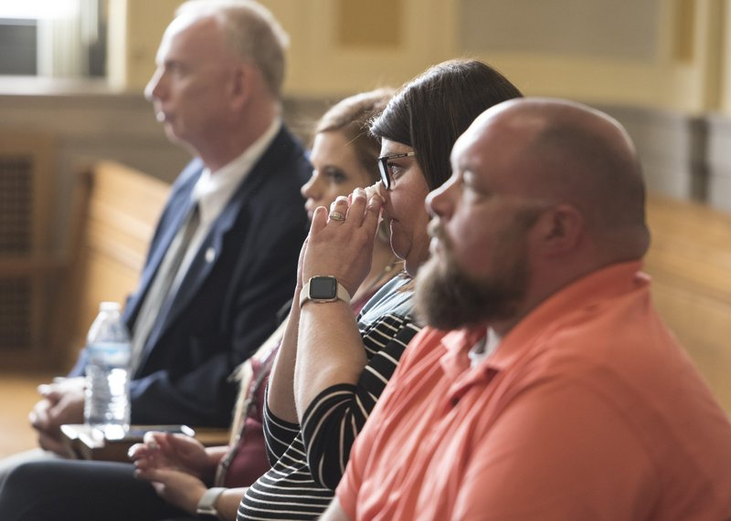 In this Wednesday, April 17, 2019 photo, Shelley Mathias emotionally sits beside her husband Matthew Mathias as Casey Pigge pleads guilty in a Scioto County Courtroom in Chillicothe, Ohio. (Robert McGraw/The Chillicothe Gazette via AP)
