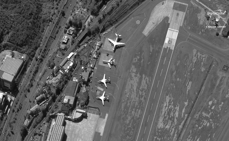 FILE - In this Dec. 10, 2018 file satellite image provided by DigitalGlobe shows the Simon Bolivar International Airport shortly after four Russian military aircraft arrived in Maiquetia, Venezuela. (DigitalGlobe, a Maxar company via AP, File)