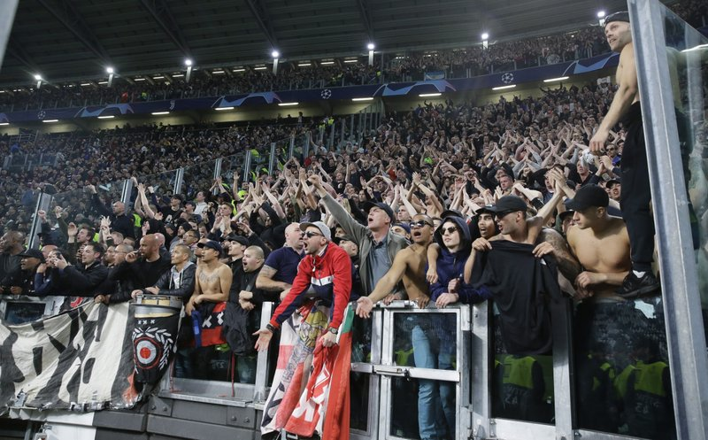 Ajax fans celebrate at the end of the Champions League, quarterfinal, second leg soccer match between Juventus and Ajax, at the Allianz stadium in Turin, Italy, Tuesday, April 16, 2019. (AP Photo/Luca Bruno)