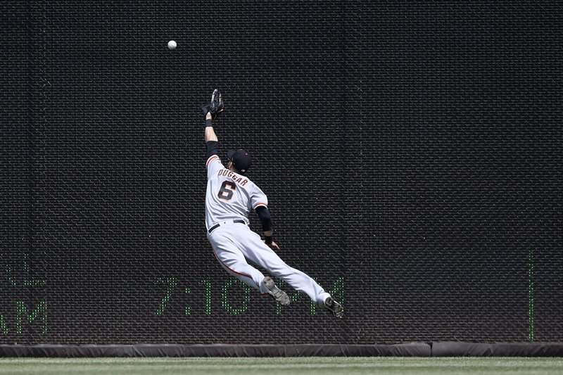 San Francisco Giants right fielder Steven Duggar (6) leaps and misses a ball that went for a double by Washington Nationals' Ryan Zimmerman during the first inning of a baseball game, Thursday, April 18, 2019, in Washington. (AP Photo/Nick Wass)