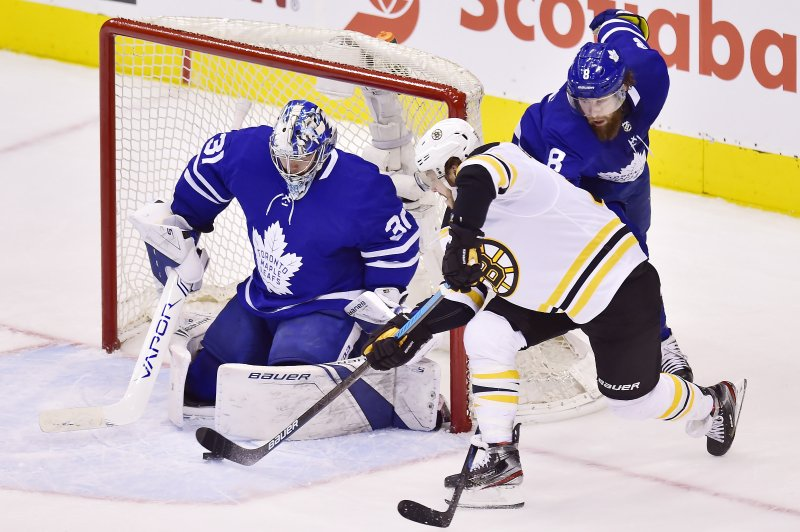 Boston Bruins right wing David Pastrnak (88) shoots on Toronto Maple Leafs goaltender Frederik Andersen (31) during the third period of Game 4 of an NHL hockey first-round playoff series Wednesday, April 17, 2019, in Toronto. (Frank Gunn/The Canadian Press via AP)