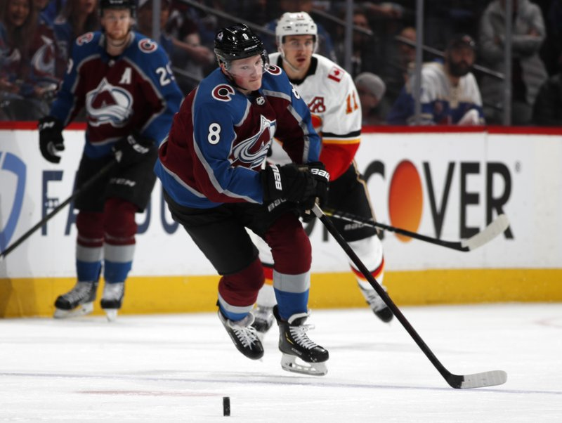 Colorado Avalanche defenseman Cale Makar, front, loses control of a pass as Calgary Flames center Mikael Backlund defends in the second period of Game 4 of an NHL hockey playoff series Wednesday, April 17, 2019, in Denver. (AP Photo/David Zalubowski)