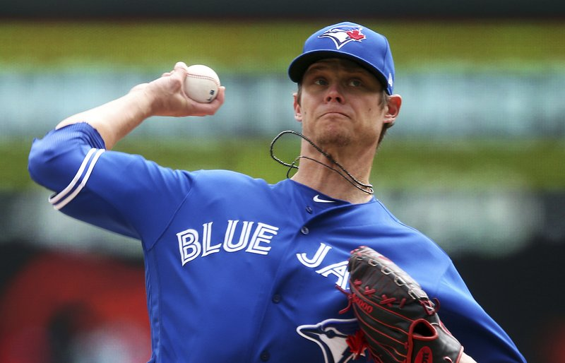 Toronto Blue Jays pitcher Clay Buchholz throws against the Minnesota Twins in the first inning of a baseball game Thursday, April 18, 2019, in Minneapolis. (AP Photo/Jim Mone)
