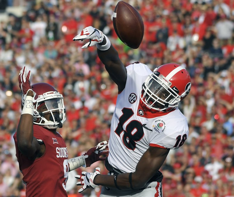FILE - In this Monday, Jan. 1, 2018, file photo, Georgia defensive back Deandre Baker (18) breaks up a pass intended for Oklahoma wide receiver CeeDee Lamb, left, during the first half of the Rose Bowl NCAA college football game in Pasadena, Calif. (AP Photo/Mark J. Terrill, File)