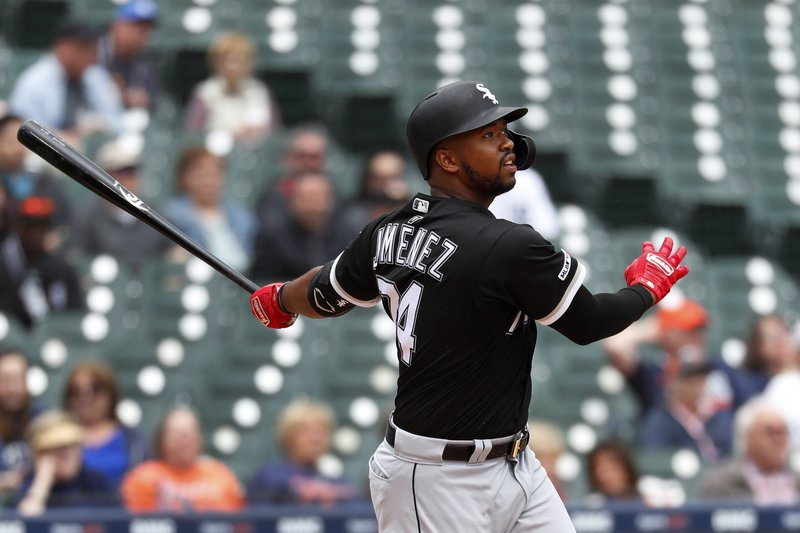 Chicago White Sox's Eloy Jimenez hits a two-run home run against the Detroit Tigers in the sixth inning of a baseball game in Detroit, Thursday, April 18, 2019. (AP Photo/Paul Sancya)